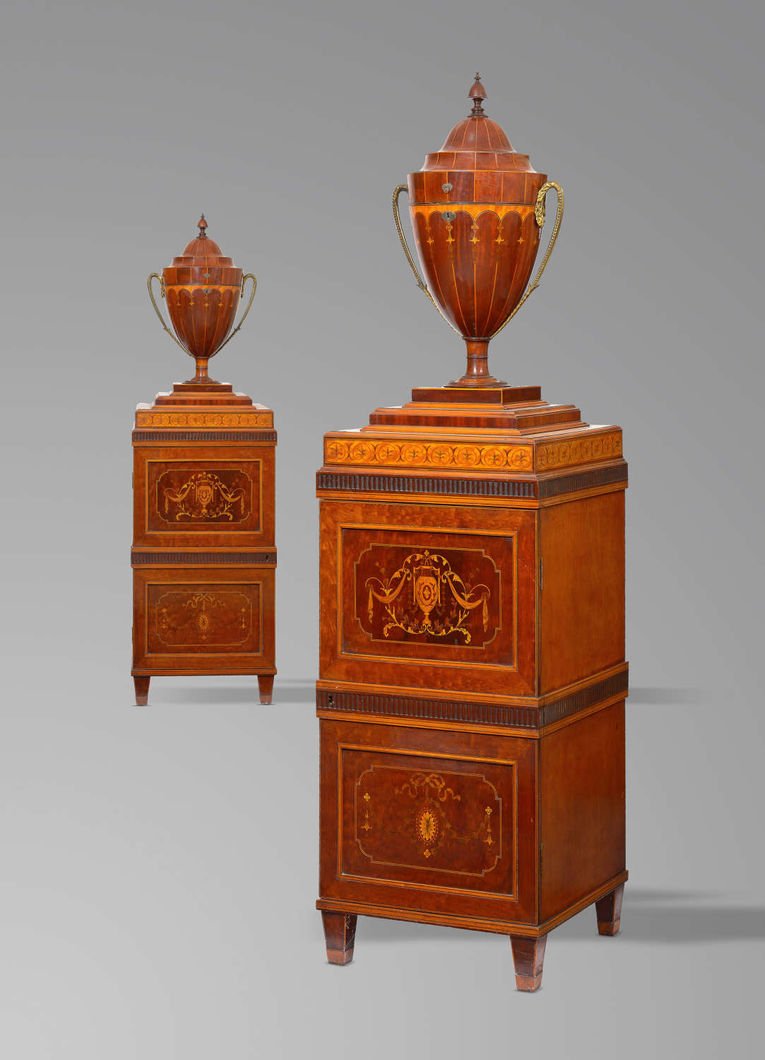 A Pair of George 111 Mahogany and satinwood cutlery Urns on pedestals
